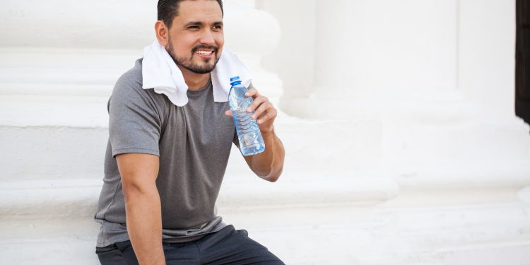 Attractive Athlete Drinking Water Outdoors