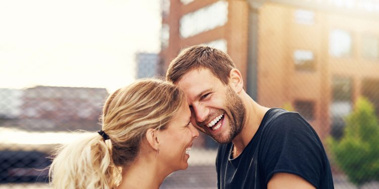 Happy Spontaneous Couple Share A Good Joke