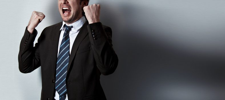 screaming businessman standing in front of a wall